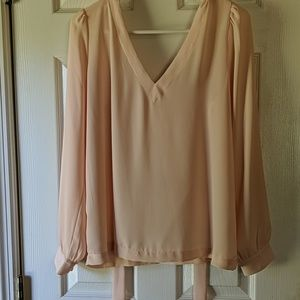 Pale pink sheer blouse with back tie detail